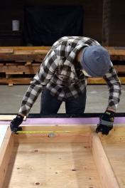 Measuring the width between joists.