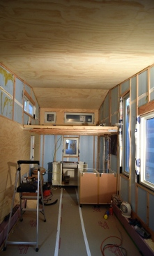 "The process of glueing and brad nailing the 1/4"" paneling up"