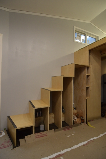 The under stair storage is coming along. the larger cavities will be our clothes storage, the small narrow cavities will be some kitchen storage (wine? glasses? etc...) and the large cavity behind the sheet of plywood faces the kitchen and will be infilled with shelving for kitchen storage.