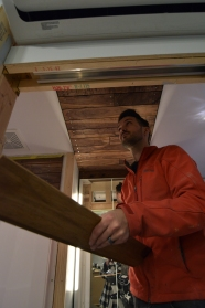 Installing the last of the walnut on the bathroom ceiling