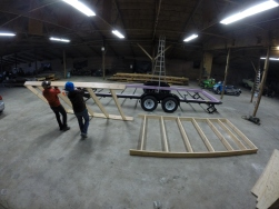 Framing the 2x6 floor next to the trailer.