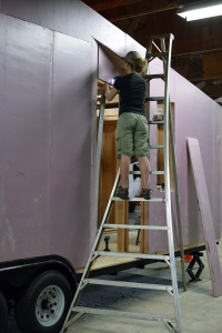 putting on the final peices of sheathing in our newly framed door indentation