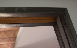 Steel angle pocket door trim